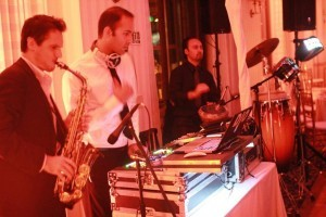 dj band in los angeles with saxophone and drummer